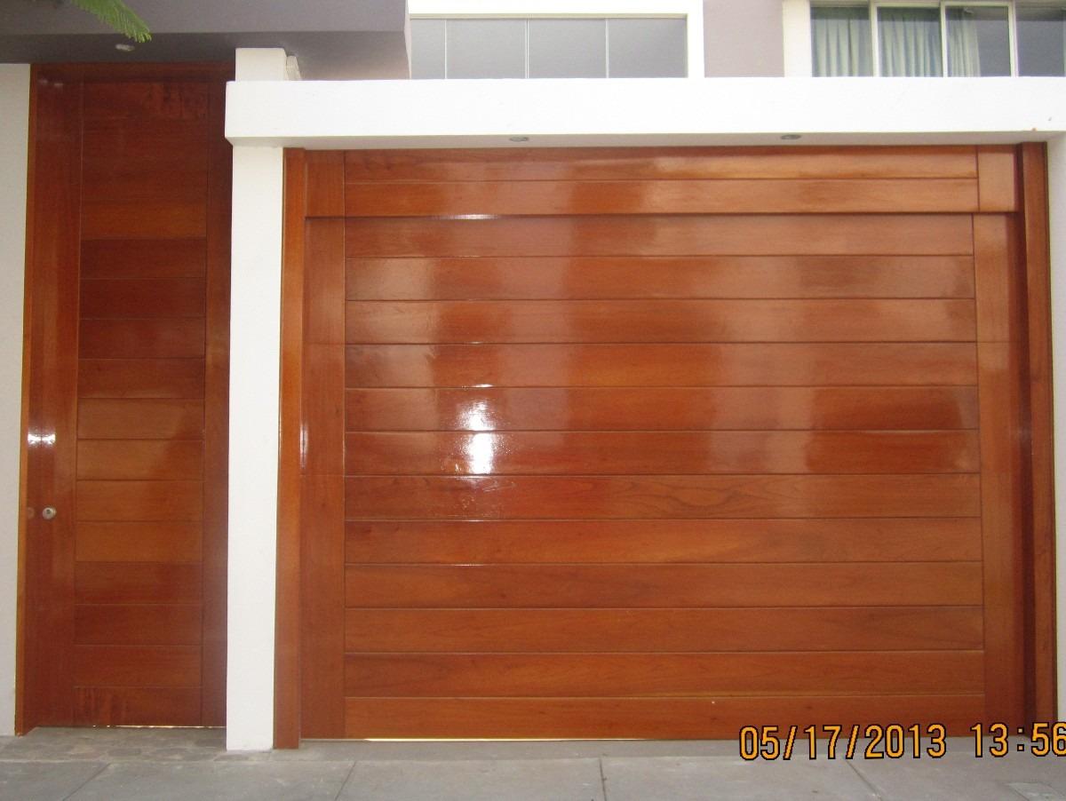 Puertas de garaje en madera y fierro seccionales levadizos - Garage de madera ...